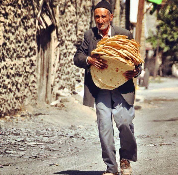 elderly man comes home with fresh naan.via Iranian People ,Iran