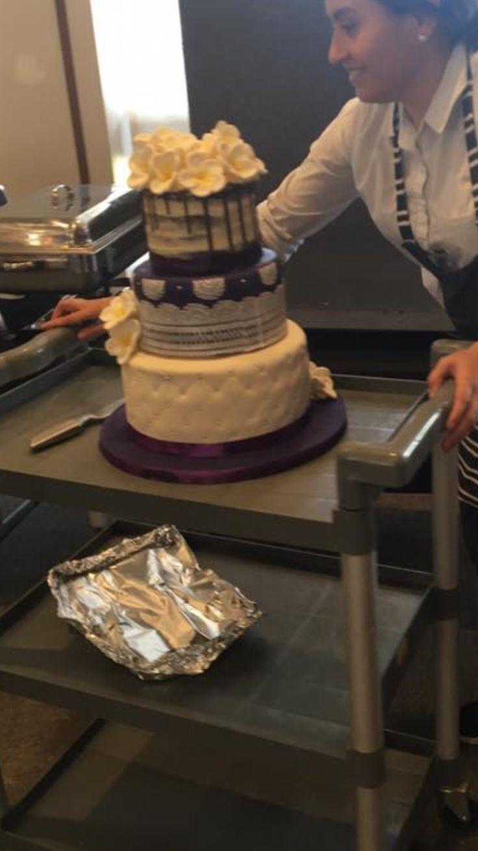 3 tier purple wedding cake frangipani flowers & veil lace.  chocolate, carrot cake & chocolate #purplewedding #frangipani
