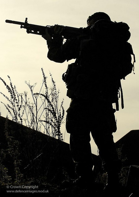 A Royal Marine from Charlie Company, 40 Commando is pictured aiming a General Purpose Machine Gun (GPMG) during FIBUA (Fighting in a Built Up Area) training.