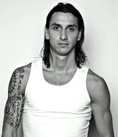 Ibrahimovic and his long hairstyle and tattoos wearing a tank top. View more tattoo designs .