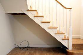 Just in time for Thanksgiving, I'm happy to reveal our new under-the-staircase built-in storage!