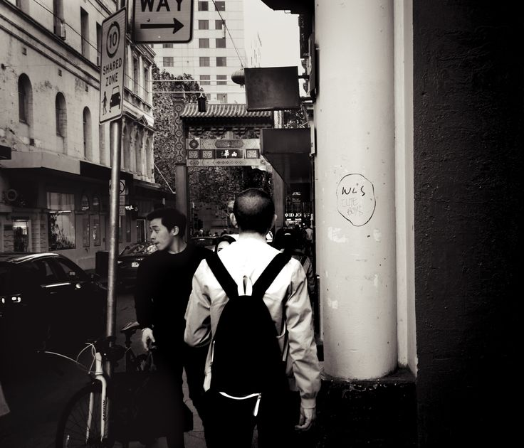 China Town, Melbourne - 03/05/2016 - Georgia Urquhart --- FINAL --- I enjoyed the colour version but i wanted to see if i could make the guy more prominent and i thought black and white was a solid way of doing that. It's almost as if it looks like the guy  is standing in front of a big print of china town, not actually in the scene himself.