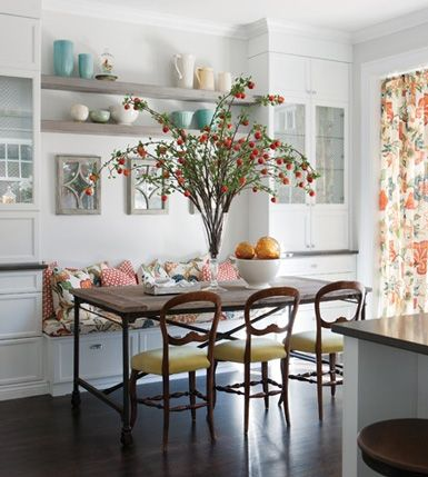 I love the idea of a built-in, cozy bench on one side of the table and chairs on the other.