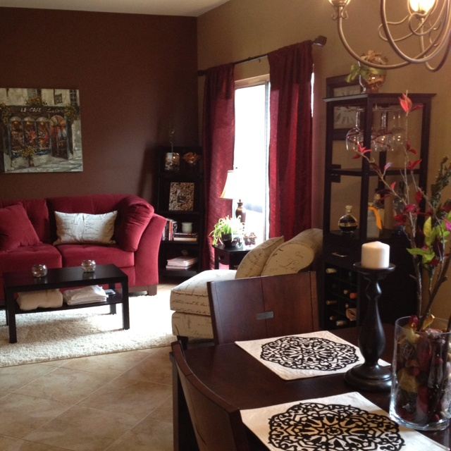 burgundy and black living room we an open kitchen with a sitting area 20394