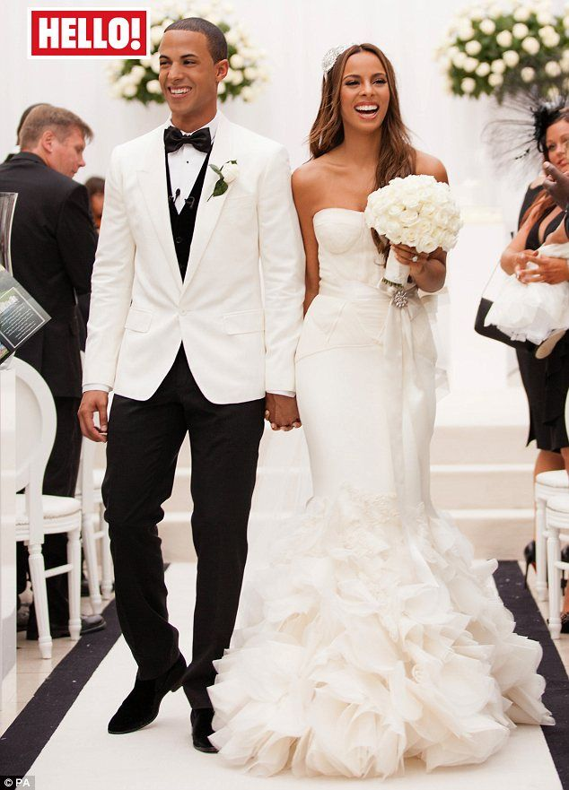 : Marvin Humes from JLS and Rochelle Wiseman from the Saturdays walk down the aisle beaming after becoming man and wife