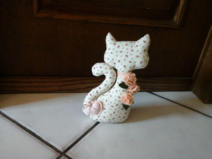 Gattino fermaporta con rose