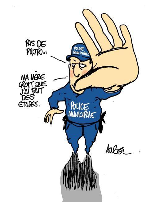 Dessin d'Aurel sur la police municipale et les photos