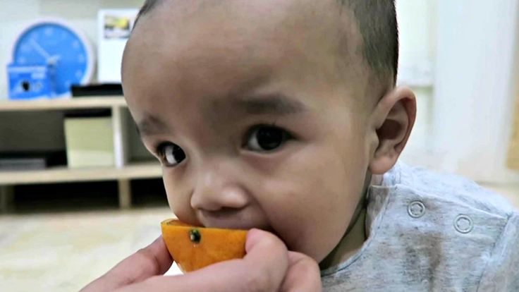Baby 9 Months Learning to eat oranges Sunkist