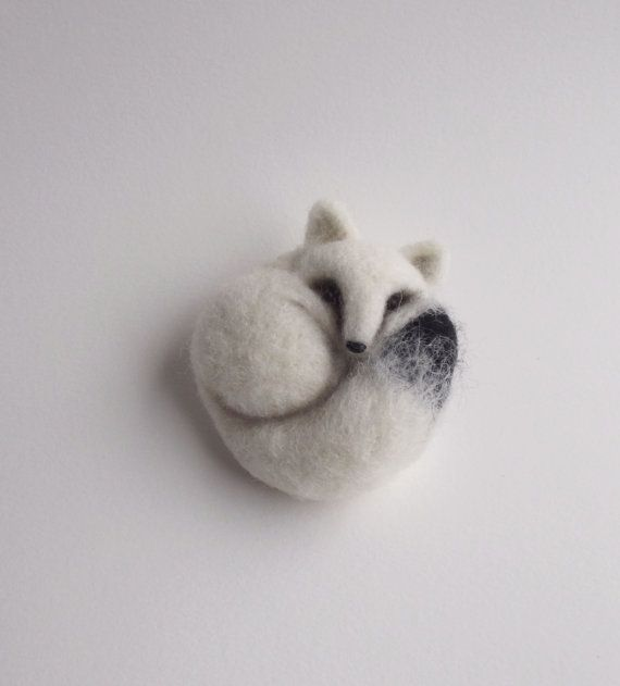 This cute little buddy is completely needle felted from a 100% wool. It is perfect for your jacket, bag or a hat because it is a real eye