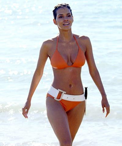 Halle Berry copies iconic bikini scene. Ursula Andress voted best Bond beach body of all time