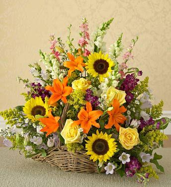 Harvest Basket   A large basket arrangement containing sunflowers, lilies, campanula, solidago, roses, stock, snapdragons and asters.