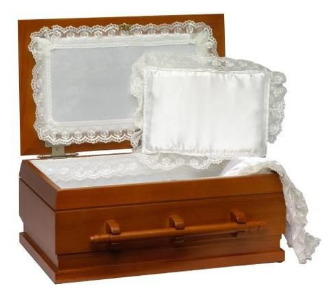 This elegant wooden pet casket is hand-crafted from oak wood and contains a high-quality white cloth lining and a plush white pillow. This casket is one of the finest pet caskets available in the USA
