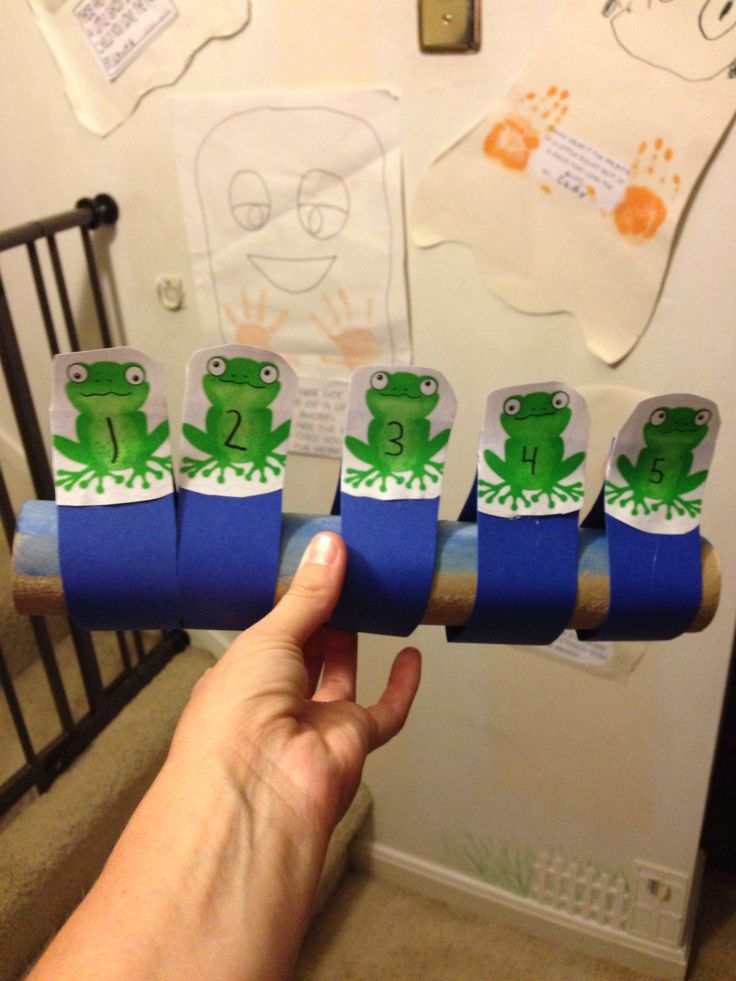 Five green and speckled frogs use an old paper towel roll for Uses for paper towel rolls