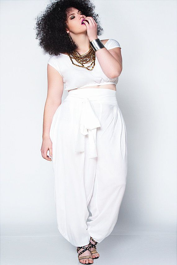White Slouch Pant. Relaxed fit. Exaggerated Hip Drape & chic side pockets. attached sash at waist. Invisible back zipper. Add a