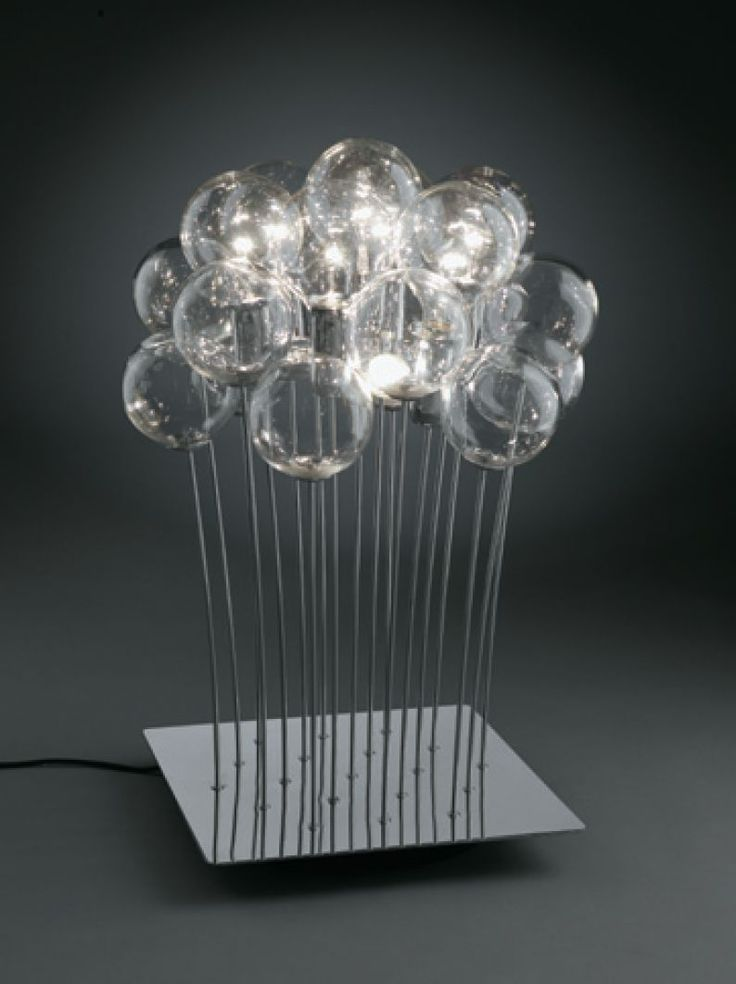 Table lamp with crystal blown spheres, and bulb socket covers in chromed metal frame. Round or square base. 7 long life globe bulbs, 3 standard bulbs and 12 spheres. Design by Marco Angoli for SP LIGHT and DESIGN srl