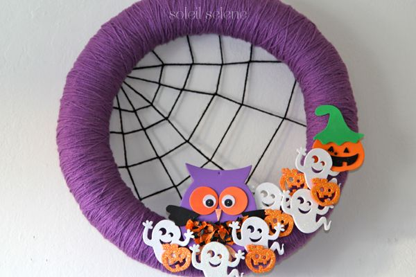 DIY Halloween Yarn Wreath---I would do without the stickers, just the yarn and spiderweb...that part is cute!