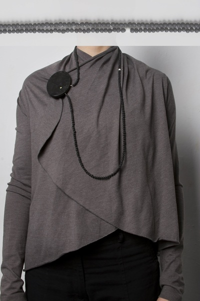 "foto: Marta Sulkowska / gray flamingo, ""Fireflies"" series, brooch/necklace, painted wood, handmade beads, steel, fluorescent"