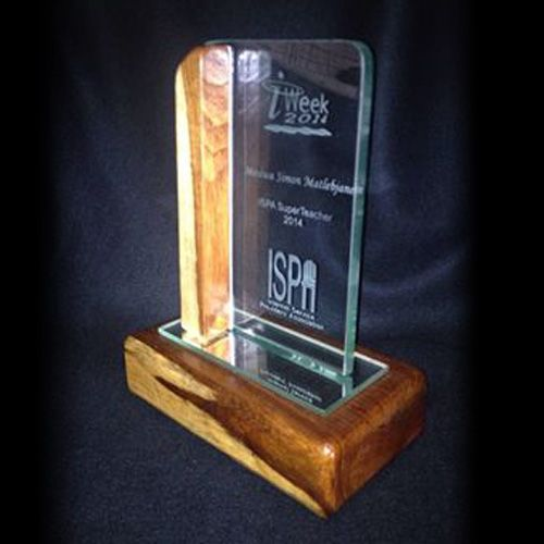 Custom Trophy by Sirprize. Wooden base with sandblasted glass.