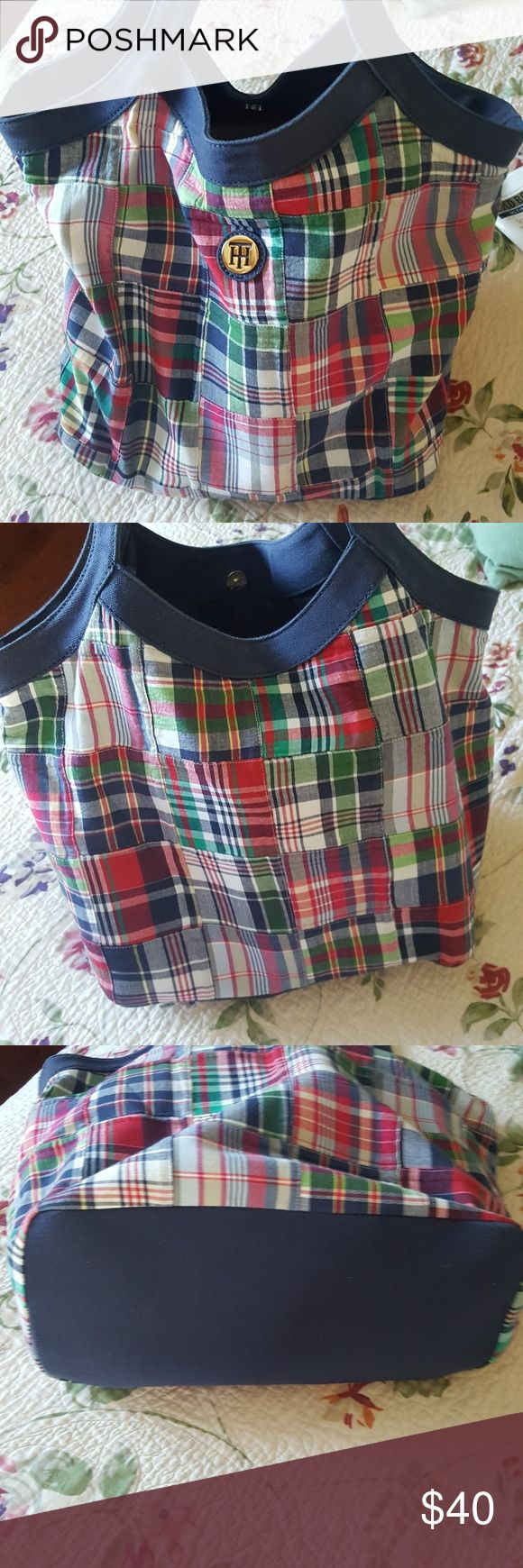 TOMMY HILFIGER bag TOMMY HILFIGER BAG, very  roomy,  cute plaid pattern. PERFECT NEW condition.  Wear over shoulder or in crook of arm.  Perfect for spring/summer.  Looks adorable with jeans. FAST SHIPPER 5??RATED Tommy Hilfiger Bags Totes