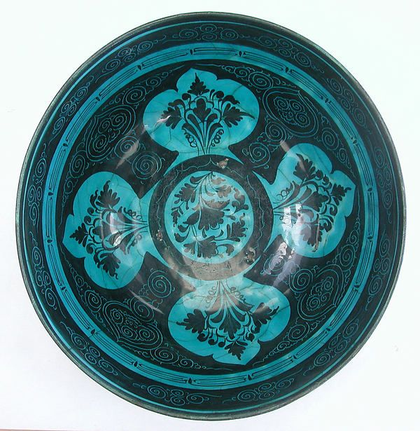 Bowl Date: second half 15th century Geography: Iran, probably Tabriz Culture: Islamic Medium: Stonepaste; painted in black under turquoise glaze, incised (Kubachi ware) Dimensions: H. 5 3/4 in. (14.6 cm) Diam. 12 3/8 in. (31.4 cm)