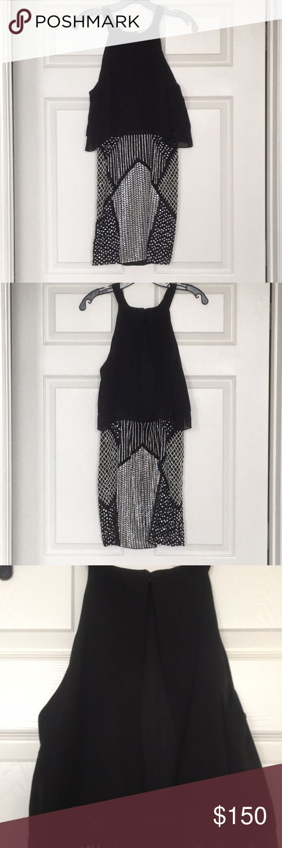 Beaded Black and White Parker Dress Halterneck party dress made by Parker. Open back. Skirt and top are attached. Hook and eye closure at the neck and zipper in back of the skirt. Beaded skirt is fully lined. Comes with extra replacement beads. Only worn once. Parker Dresses Mini