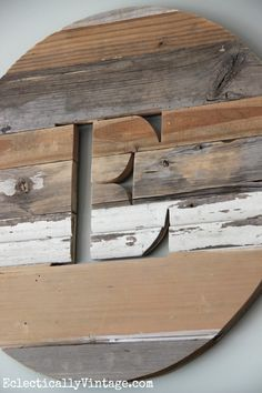 LOVE this rustic wood monogram - it's completely customizable - you can choose wood colors and more eclecticallyvintage.com