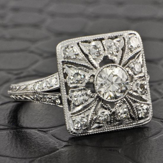 Art Deco Style Diamond Ring.   Vintage platinum ring features one 0.50 carat Old European-cut diamond in a bezel setting at the center of a vintage pierced square mounting...