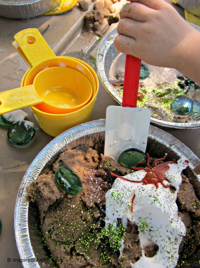 Stirring Up a Kids Mud Pies at a Messy Playdate at B-InspiredMama.com - adding shaving cream is a brilliant idea!