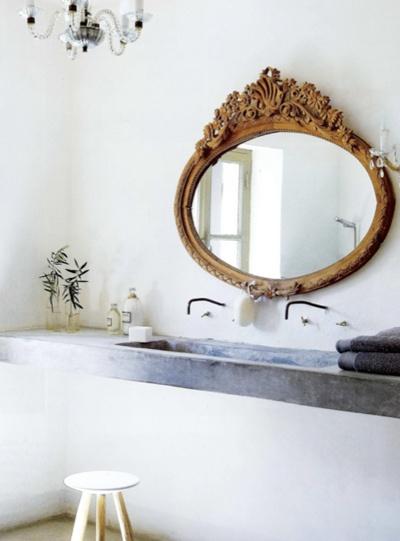 Concrete sink/ornate mirror