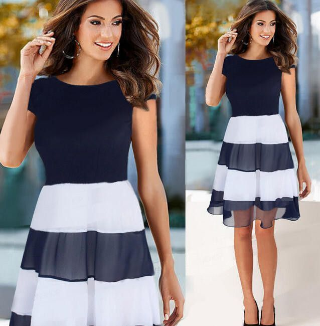 This dress screams classic beauty! Featuring a Navy top with a navy and white pleat skirt. The soft fabric is light weight and perfect for those hot summer days. Hand Wash Cold - Lay Flat to Dry Sizes