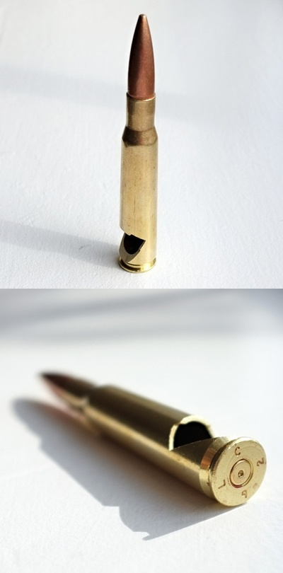 50 cal. bullet bottle opener.  I like Kim's idea of using these as groomsmen gifts, but I need one of these in my own life as well!