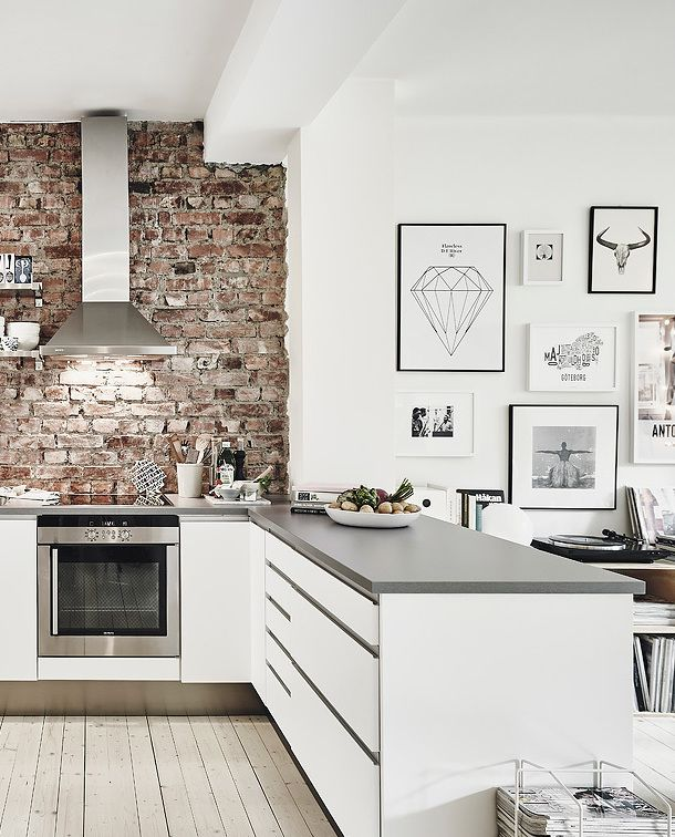 cozy kitchen* brick* white & stainless steel* minimal art black frames*:
