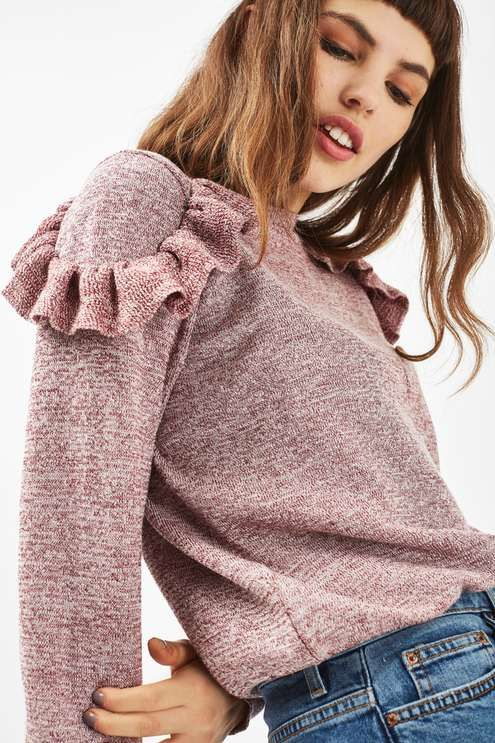 Add a flash of femininity to your casual-cool styles with this long sleeved jumper with ruffle shoulder detailing. Create a contrast look with a pair of frayed jeans. #Topshop