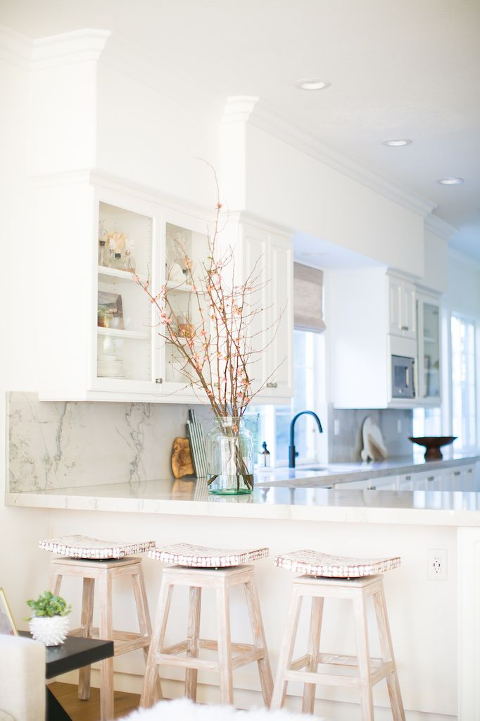 coastal bohemian kitchen with marble counters, royal oak cane wood floors and matte black faucets