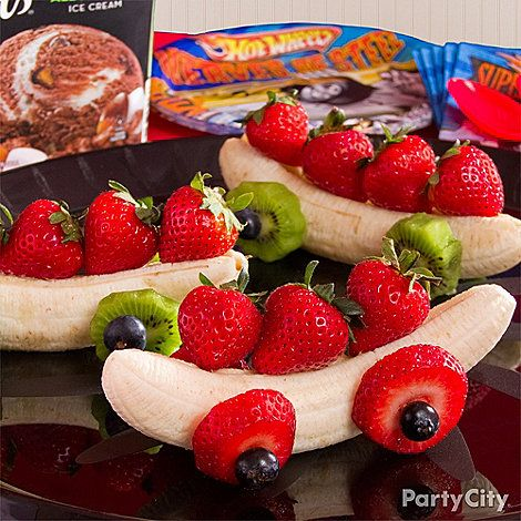 Fruit Race Cars- For wheels, slide a blueberry and a slice of strawberry or kiwi onto a bamboo skewer, insert it in the banana and finish w/ another fruit slice and blueberry. Lay more fruit along the top of the banana for passengers and serve!