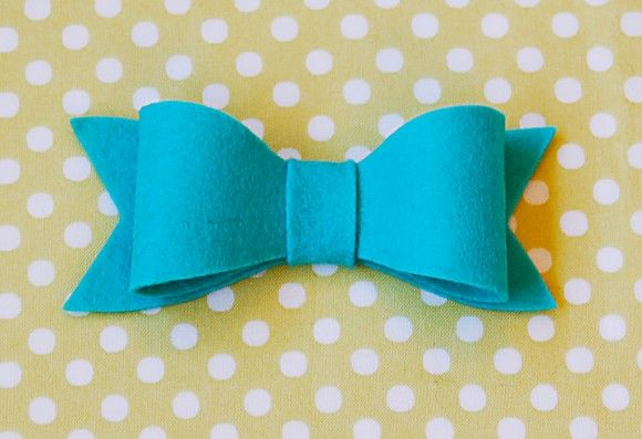 felt bows with sewing. really the same as with a hot glue gun.