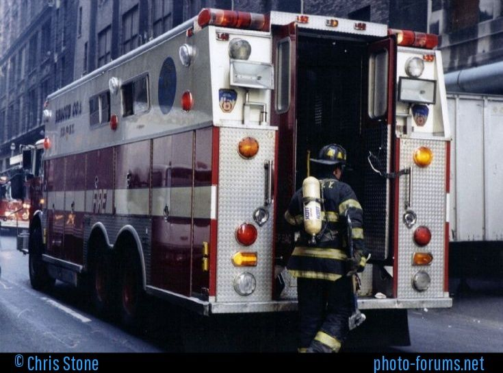 Fire Department city of New York, a rear shot of Rescue 1's 1985 Mack/Saulsbury Rescue unit at a rubbish compactor fire Sept 4th 1996