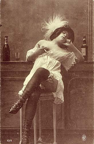 Absinthe Poster of an early French postcard showing a bar girl or prostitute flanked by an Absinthe bottle; original poster size 15 x 10cm.