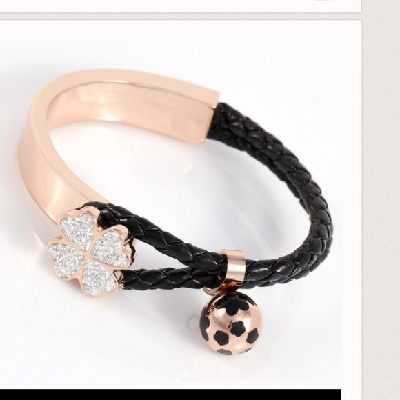 Leather, stainless steel bangle Brand new bangle with genuine leather and gold plated stainless steel. Clovers have zirconia stones. Jewelry Bracelets