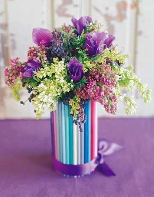 Colored pencil vase  Magnify the hues of gifts from the garden with a kaleidoscope of colored pencils hot-glued to a glass vase or jar. Fill the vase with your favorite blossoms (we chose purple and white lilacs, anemone, and privet berry) and tie a bow (we used double-faced satin ribbon) around the bottom.