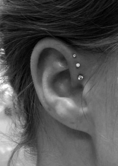 This is so pretty...  Triple forward helix is my next piercing.