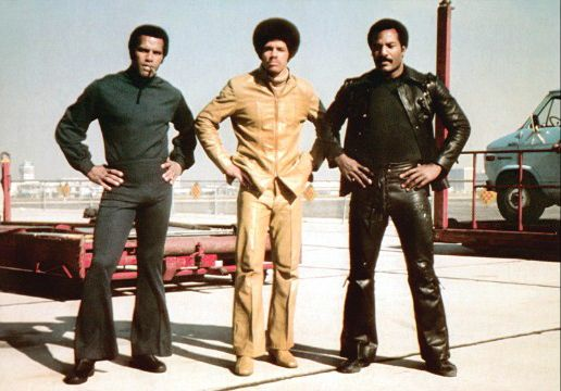"""Jim Kelly in the movie """"Three the Hard Way"""" with Fred Williamson and Jim Brown in 1974."""