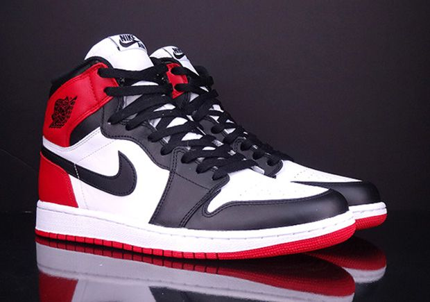 The Air Jordan 1 Black Toe is set to release this November 2016 featuring the iconic original colors of White, Black, and Gym Red.