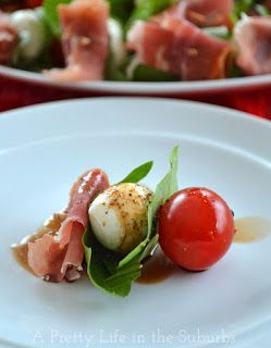 Cherry tomatoes, mozzarella balls, prosciutto and basil then drizzle a little balsamic glaze!