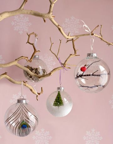 Fill one with small wooden chips, another with a single stunning peacock feather (attached to the ornament's top with hot glue). Or compose a more obvious Christmas scene by dropping a model fir tree into a globe dusted with artificial snow. You can also use tweezers to position branches inside and even hot-glue a tiny cardinal in place.