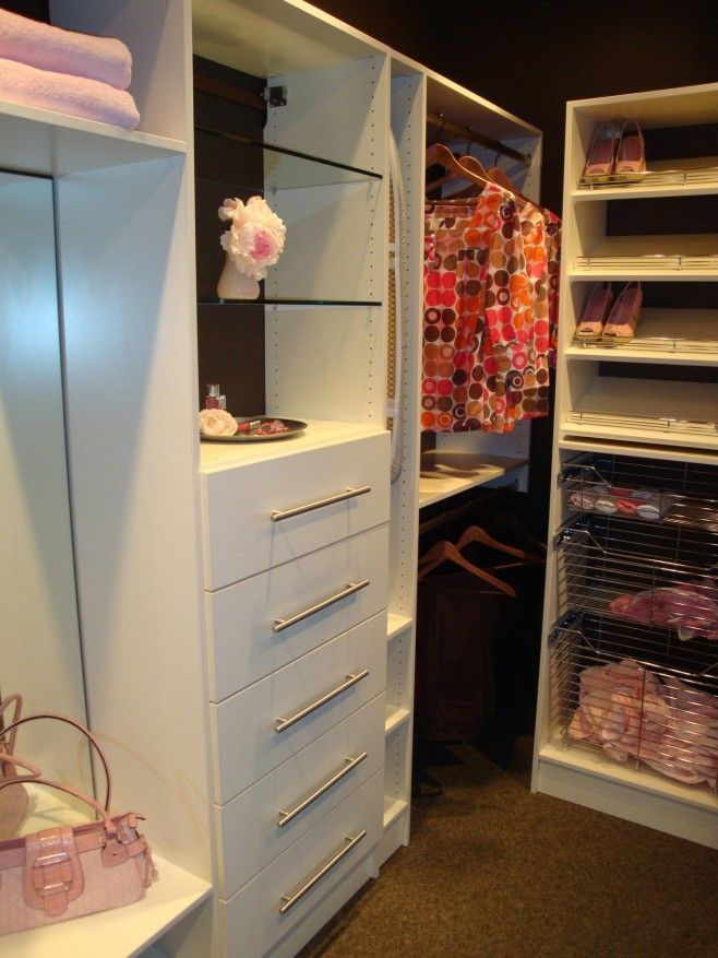 This is a light, airy solution for a walk-in closet. Balsa Wood Solutions    Tower with 5 Medium Drawers  Pull Out Chrome Baskets  Shoe Shelves  Upper and Lower Hanging Sections  Adjustable Glass Shelves  Full Length Mirror