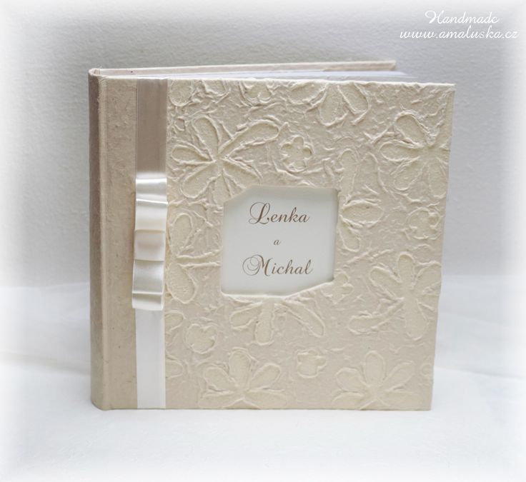 Photo album with embossed handmade paper and satin ribbon.