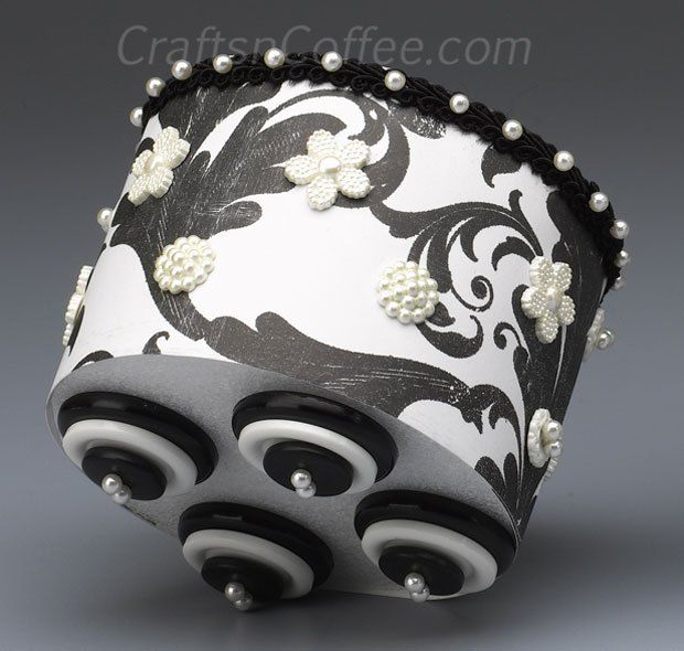 How cute are these legs made from three stacked buttons? This is a fun & easy idea for a candle pedestal.