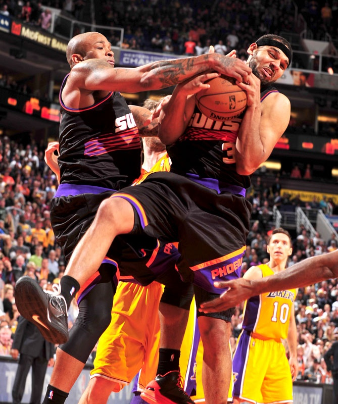 Phoenix Suns Uniforms Through the Years Jared Dudley and the Phoenix Suns  debuted their black retro jerseys in a win over the 2bf847578