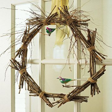 Natural Twig Wreath  In this natural creation, branches from the yard are bound together to form a wreath. Smaller twigs soften the overall effect. The clip-on bird ornaments stay with the theme.